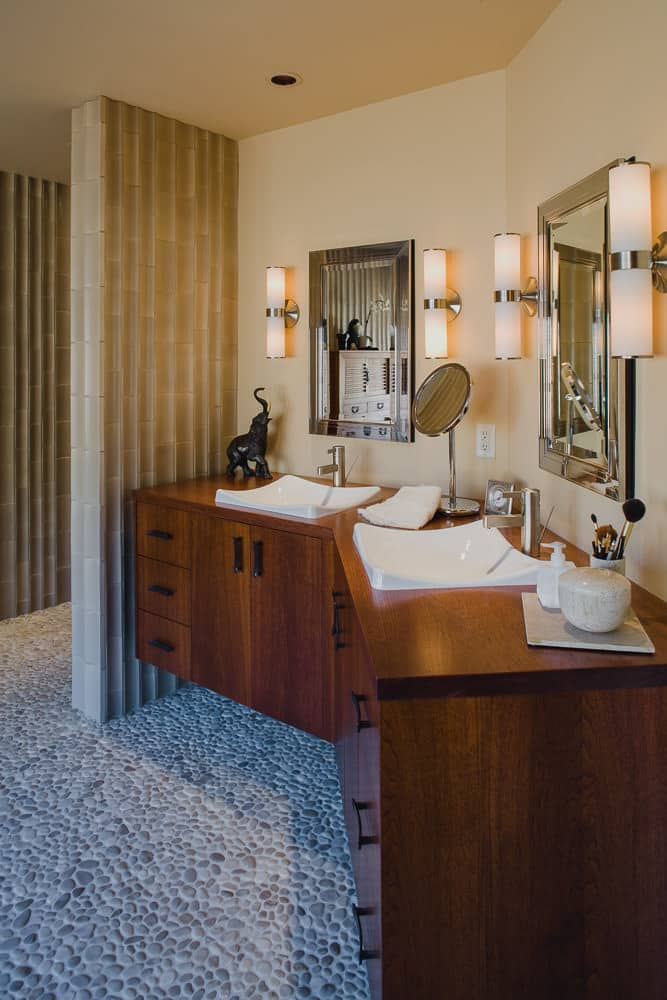 master bath, pebble tile floor, floating cabinet, mirror, wood counter