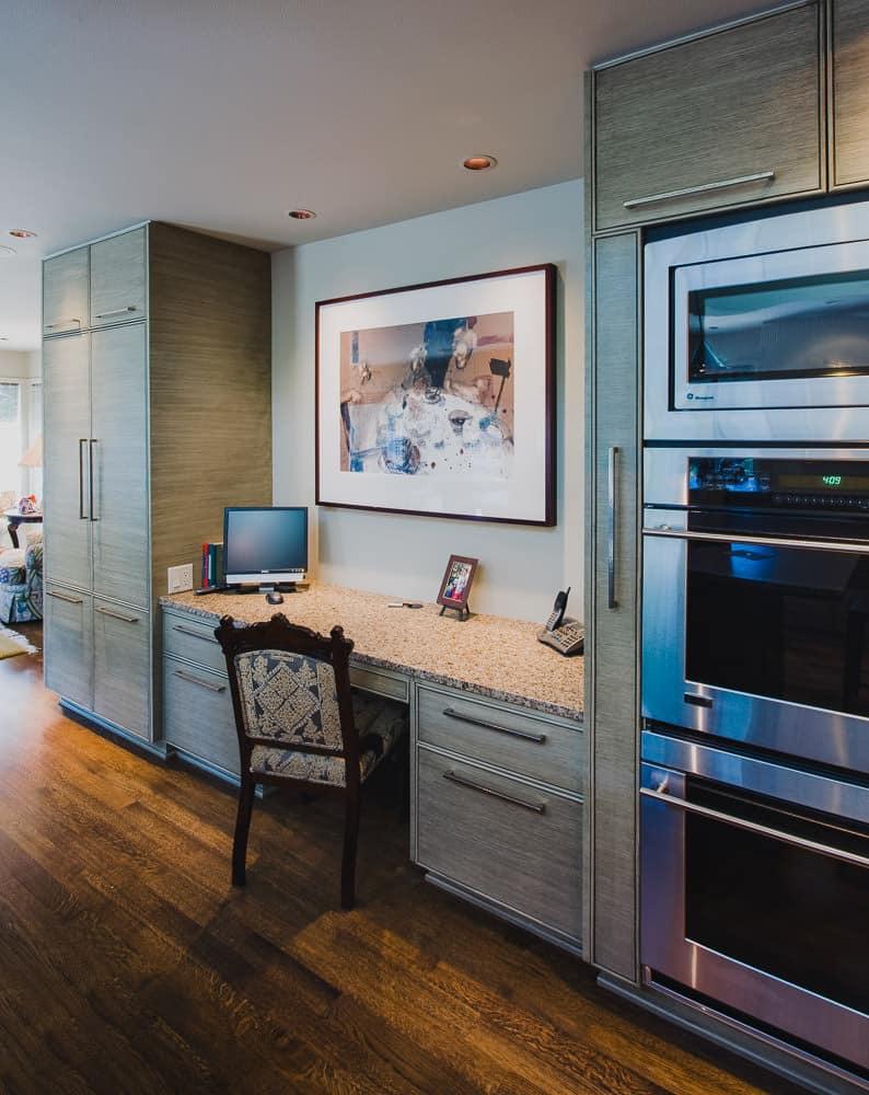 kitchen, desk, ovens, hardwood floor, granite counter