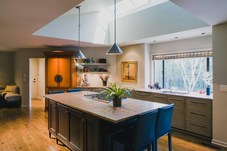 kitchen, island, pendant light, skylight, granite counter, custom refrigerator