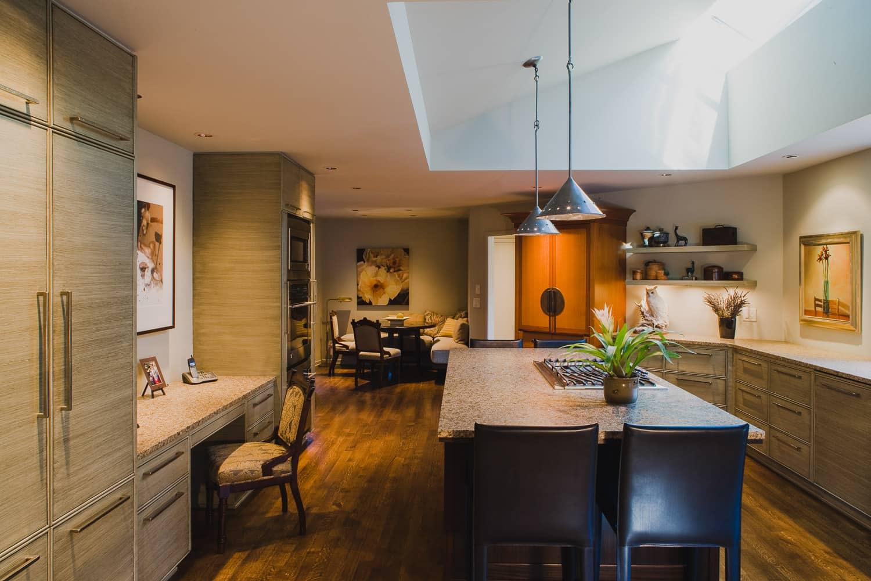 kitchen, hardwood floor, island, granite counter, desk, faux finish cabinet, pendant light, skylight